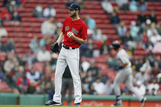 Boston Red Sox's Chris Sale stands on the mound after giving up a solo home run to Detroit Tigers' Grayson Greiner, right, during the fifth inning in the first game of a baseball doubleheader in Boston, Tuesday, April 23, 2019. (AP Photo/Michael Dwyer)