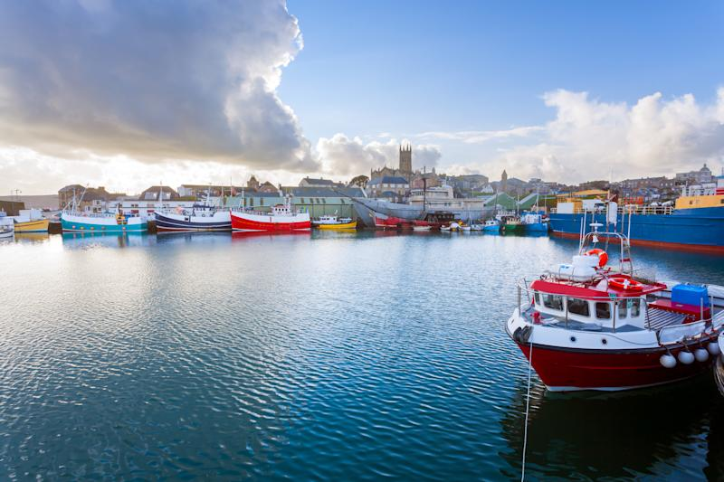 Stroll along Penzance Harbour. [Photo: Getty]
