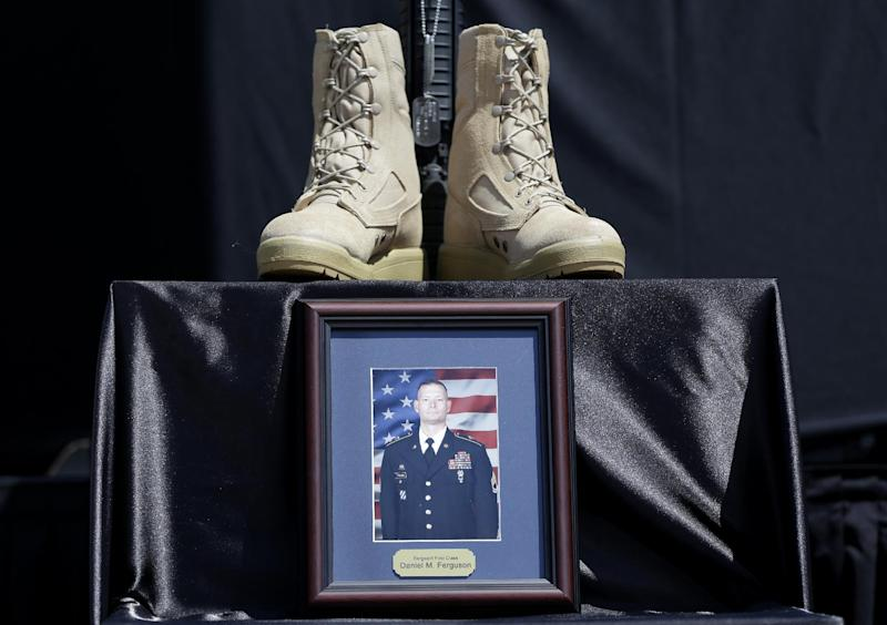 Part of a Soldiers Cross for Sgt. Danny Ferguson of Mulberry, Fla., is set near the stage before a memorial ceremony where President Barack Obama with speak, Wednesday, April 9, 2014, at Fort Hood, Texas, for those killed there in a shooting last week. President Barack Obama is reprising his role as chief comforter as he returns once again to a grief-stricken corner of America to mourn with the families of those killed last week at Fort Hood and offer solace to the nation. (AP Photo/Carolyn Kaster)