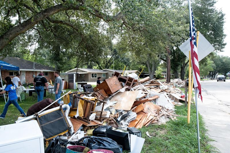 Crewsof volunteers help locals in Katy rip out damaged furniture, roofing, flooring and wood from homes. (JOSEPH RUSHMORE FOR HUFFPOST)