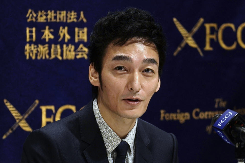 "Tsuyoshi Kusanagi, a former member of Japanese popular pop group SMAP, speaks during a press conference of a new film ""Midnight Swan"" at Foreign Correspondents' Club of Japan in Tokyo Friday, Oct. 9, 2020. (AP Photo/Eugene Hoshiko)"