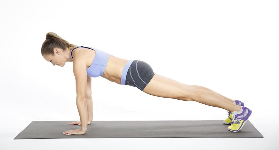 <ul> <li>Balance on the hands and toes with the body in one straight line, hands underneath the shoulders and feet hips-width distance apart.</li> <li>Pull your abs to your spine, and hold this position for 30 to 60 seconds. This counts as one rep.</li> </ul>