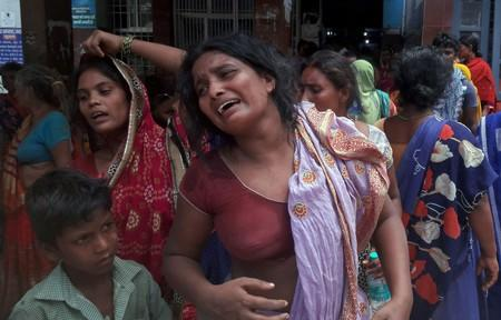 Relatives of the victims of a mob lynching incident mourn outside a hospital in Chapra
