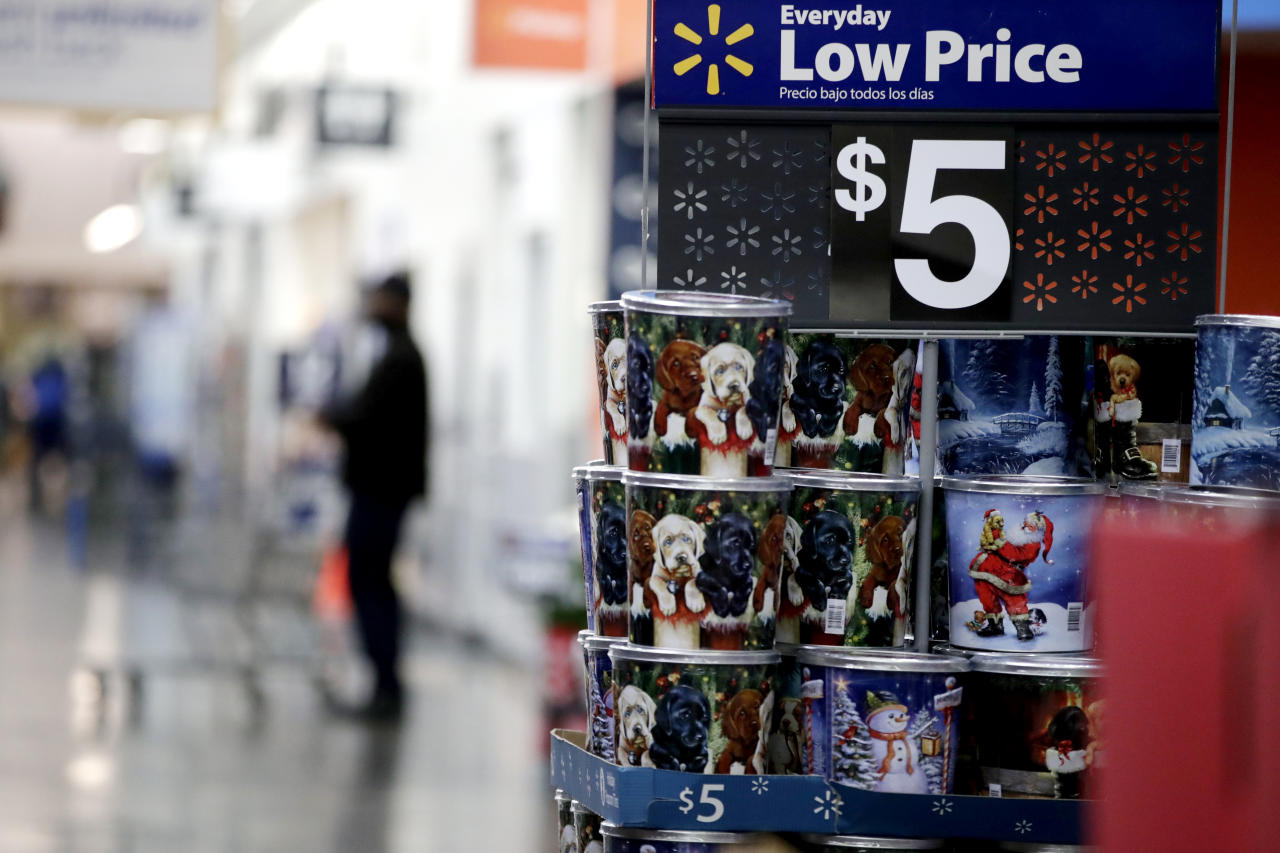 FILE- In this Nov. 9, 2017, file photo items are seen on display ahead of the holiday shopping season at a Walmart store in North Bergen, N.J. Walmart Inc. is making two improvements to its third-party marketplace heading into the holidays as it seeks to better compete with online leader Amazon.com. (AP Photo/Julio Cortez, File)