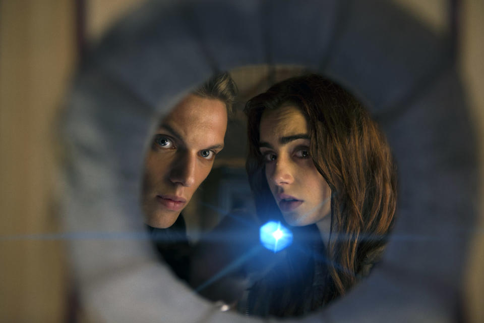 """This film publicity image released by Screen Gems shows Jamie Campbell Bower as Jace, left, and Lilly Collins as Clary in a scene from """"The Mortal Instruments: City of Bones. (AP Photo/Sony Pictures Screen Gems, Rafy)"""