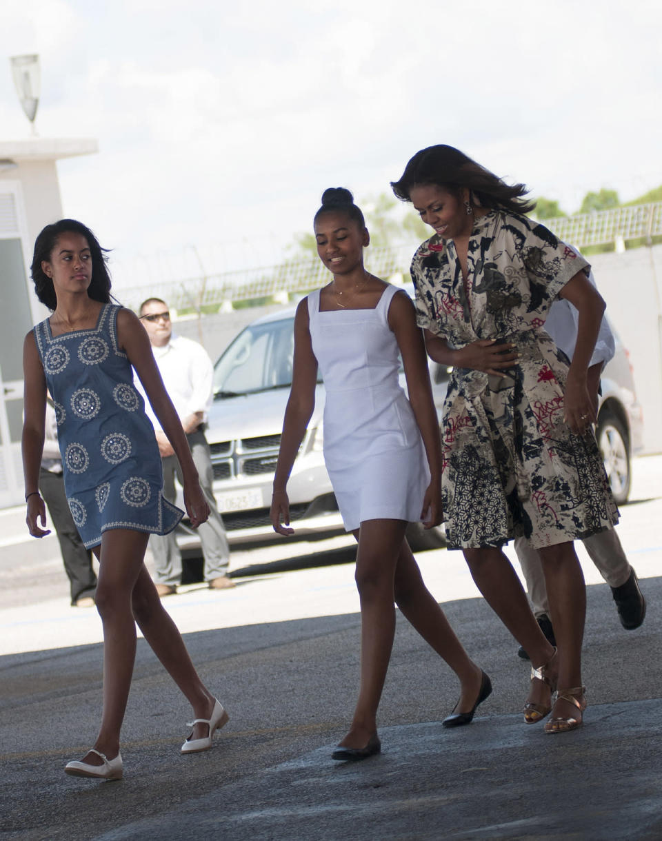 <p>Sure, Michelle Obama's graffiti-inspired dress is cool, but it was her daughters in darling Tory Burch summer minis that really stole the spotlight. </p>