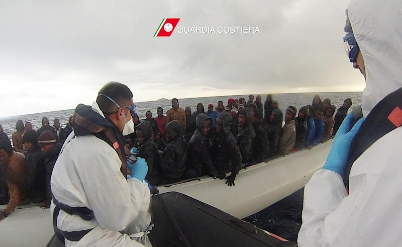 This handout video grab released by the Italian Coast Guard shows a rescue operation of migrants off the coast of Sicily on February 14, 2015 (AFP Photo/-)