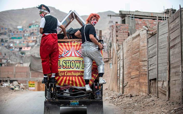 The performers are travelling around in a mototaxi - AFP