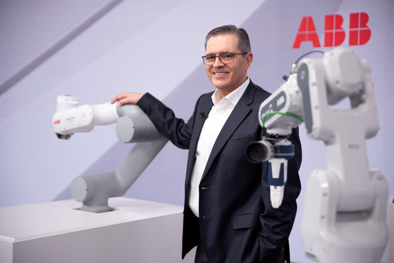 FILE PHOTO: Head of ABB Robotics and Discrete Automation business Sami Atiya poses next to robots in Zurich