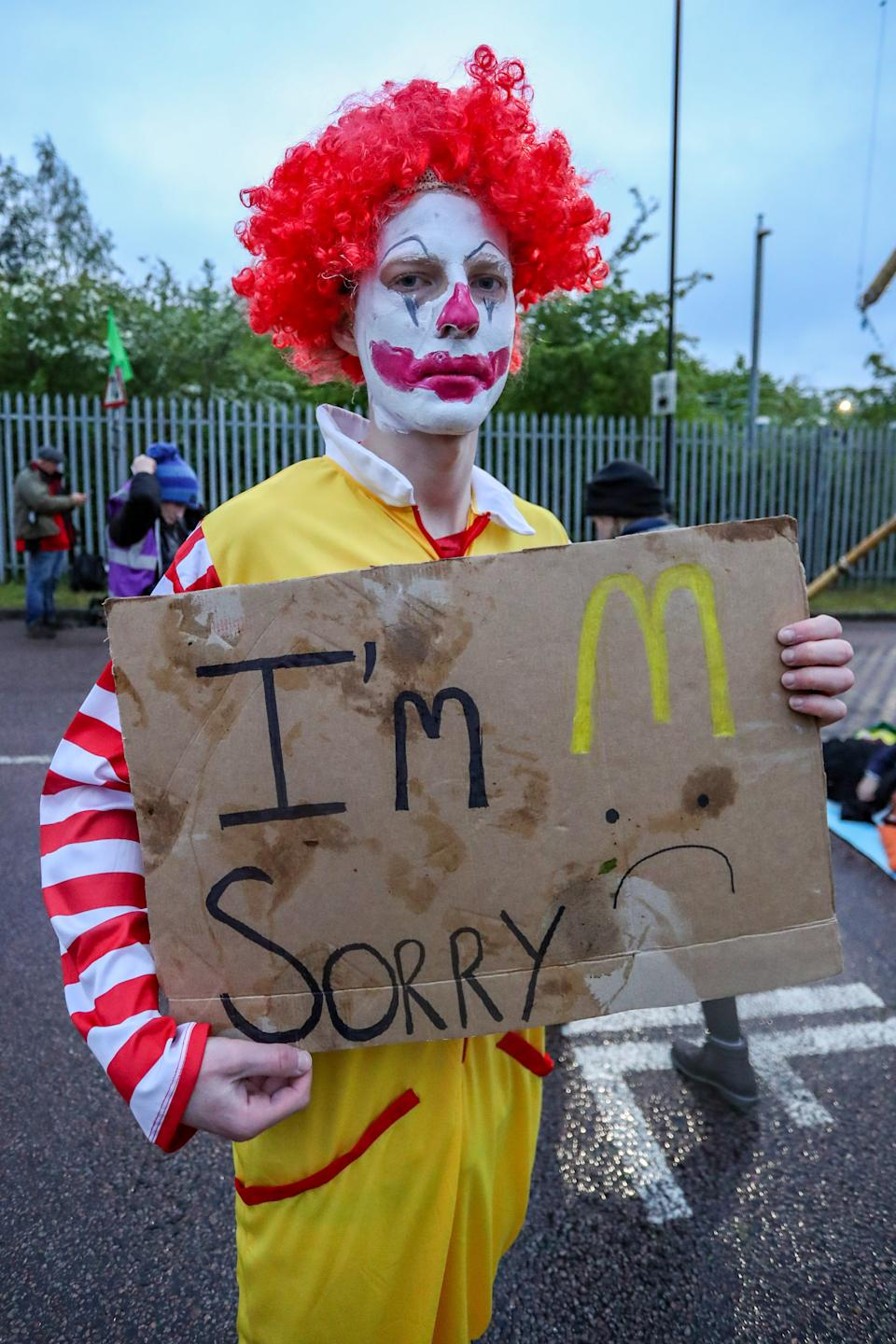 LONDON, UNITED KINGDOM - MAY 22: Protestors gather outside McDonalds distribution center in Hemel Hempstead Industrial Estate in North London on the early morning of Saturday, May 22, 2021 - to blockade the site for at least 24 hours, using trucks and bamboo structures, causing a significant disruption to the McDonald's supply chain. (Photo by Vudi Xhymshiti/Anadolu Agency via Getty Images)