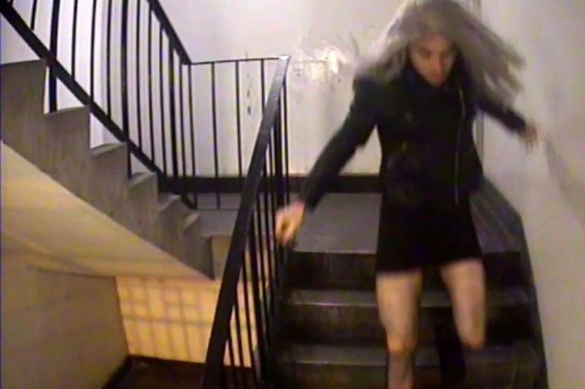 Caught on camera: Mark Brown, in a wig and dress, leaving his north London home before following his 18-year-old alleged victim after a freshers' week night out