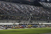 Alex Bowman (88) and Jimmie Johnson (48) lead the field to start the second of two NASCAR Daytona 500 qualifying auto races at Daytona International Speedway, Thursday, Feb. 13, 2020, in Daytona Beach, Fla. (AP Photo/Terry Renna)