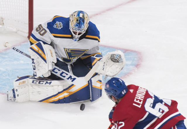 St. Louis Blues goaltender Jordan Binnington makes a save against Montreal Canadiens' Artturi Lehkonen during first period NHL hockey action in Montreal, Saturday, Oct. 12, 2019. (Graham Hughes/The Canadian Press via AP)