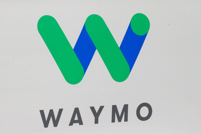 FILE PHOTO - The Waymo logo is displayed during the company's unveil of a self-driving Chrysler Pacifica minivan during the North American International Auto Show in Detroit