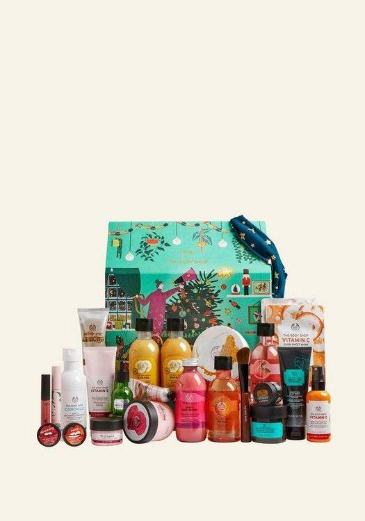 """<p><strong>the body shop</strong></p><p>thebodyshop.com</p><p><strong>$169.00</strong></p><p><a href=""""https://go.redirectingat.com?id=74968X1596630&url=https%3A%2F%2Fwww.thebodyshop.com%2Fen-us%2Fgifts%2Fbeauty-advent-calendars%2Fmake-it-real-together-ultimate-advent-calendar%2Fp%2Fp003742&sref=https%3A%2F%2Fwww.townandcountrymag.com%2Fstyle%2Fbeauty-products%2Fnews%2Fg2919%2Fbeauty-advent-calendars%2F"""" rel=""""nofollow noopener"""" target=""""_blank"""" data-ylk=""""slk:Shop Now"""" class=""""link rapid-noclick-resp"""">Shop Now</a></p><p><strong>Best For:</strong> Beauty maximalists</p><p><strong>What's Inside: </strong>Forget 24 beauty gifts, this supersized advent calendar is packed with 26 The Body Shop favorites from Almond Milk & Honey Body Butter to Himalayan Charcoal Purifying Clay Wash.</p><p><strong>MORE</strong>: <a href=""""https://www.townandcountrymag.com/style/beauty-products/g26306114/best-body-lotions/"""" rel=""""nofollow noopener"""" target=""""_blank"""" data-ylk=""""slk:The Best Body Lotions, According to Beauty Experts"""" class=""""link rapid-noclick-resp"""">The Best Body Lotions, According to Beauty Experts</a></p>"""