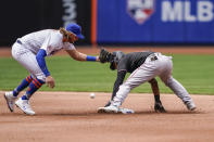 Miami Marlins' Starling Marte, right, steals second against New York Mets second baseman Jeff McNeil, left, in the fourth inning of a baseball game, Saturday, April 10, 2021, in New York. (AP Photo/John Minchillo)