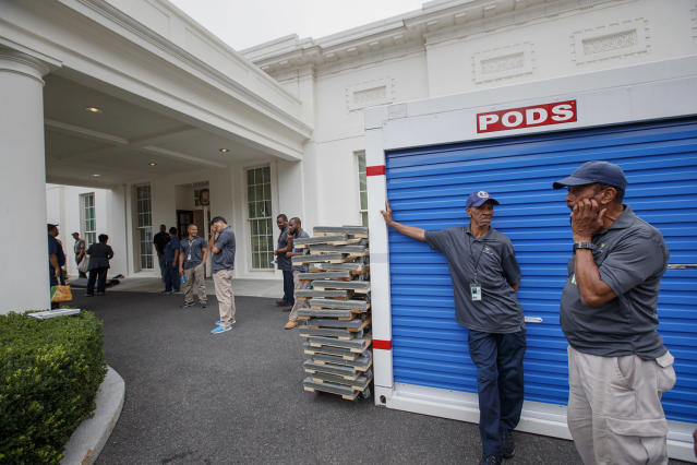 <p>Workmen wait for outside the West Wing of the White House in Washington, Friday, Aug. 11, 2017, during renovations while President Donald Trump is spending time at his golf resort in New Jersey. (AP Photo/J. Scott Applewhite) </p>
