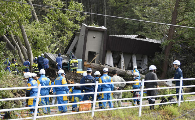 Police search for missing persons at the site of a landslide after an earthquake in Atsuma town, Hokkaido, northern Japan, Thursday, Sept. 6, 2018. A powerful earthquake hit wide areas on Japan's northernmost main island of Hokkaido early Thursday, triggering landslides as well as causing the loss of power. (Yu Nakajimai/Kyodo News via AP)