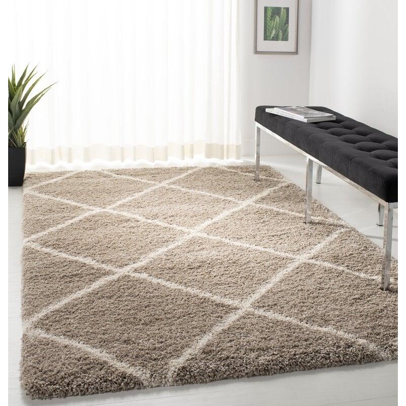 "<p>This <product href=""https://www.wayfair.com/rugs/pdp/brayden-studio-hampstead-geometric-beigeivory-area-rug-brys7284.html?piid="" target=""_blank"" class=""ga-track"" data-ga-category=""internal click"" data-ga-label=""https://www.wayfair.com/rugs/pdp/brayden-studio-hampstead-geometric-beigeivory-area-rug-brys7284.html?piid="" data-ga-action=""body text link"">Hampstead Geometric Area Rug</product> ($32, originally $94) will for sure be where you take all your naps. Its geometric design will elevate your floor.</p>"