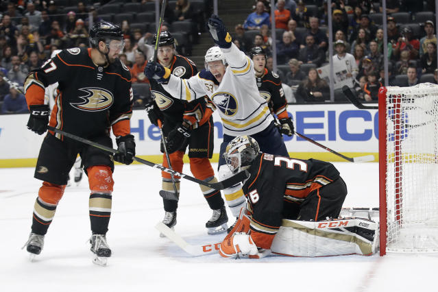 Buffalo Sabres' Jeff Skinner (53) celebrates after a goal by Victor Olofsson, not seen, past Anaheim Ducks goaltender John Gibson, bottom right, during the first period of an NHL hockey game Wednesday, Oct. 16, 2019, in Anaheim, Calif. (AP Photo/Marcio Jose Sanchez)