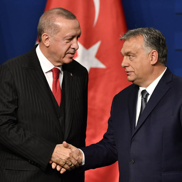 Turkish President Recep Tayyip Erdogan, left, and Hungarian Prime Minister Viktor Orban shake hands during a joint press conference after their meeting in Budapest, Hungary, Thursday, Nov. 7, 2019. (Zsolt Szigetvary/MTI via AP)