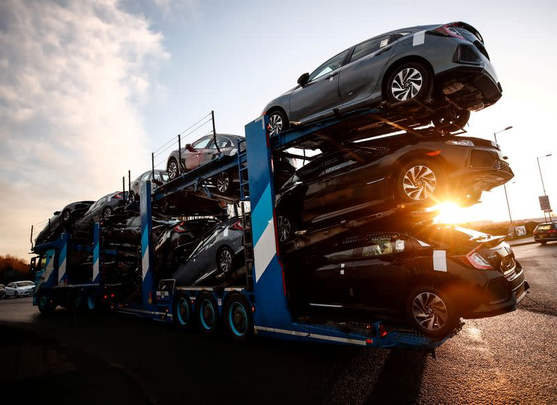 FILE PHOTO: A lorry with car carrier trailer leaves the Honda car plant in Swindon