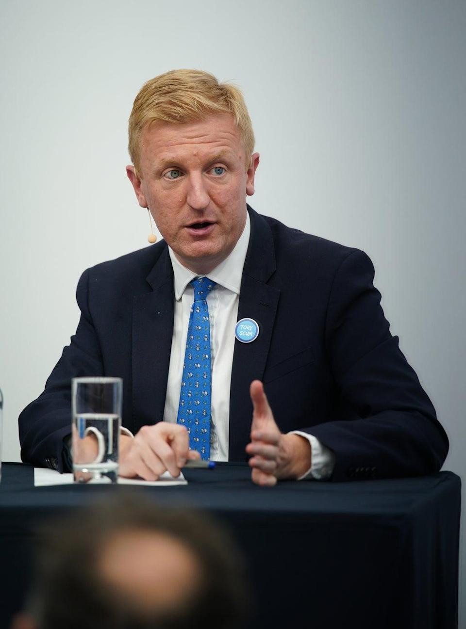 Conservative Party chairman Oliver Dowden wearing a 'Tory Scum' badge during the Conservative Party Conference in Manchester (PA) (PA Wire)