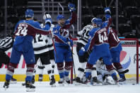Colorado Avalanche center Pierre-Edouard Bellemare (41) celebrates a goal with teammates against Los Angeles Kings goaltender Calvin Petersen (40) during the first period of an NHL hockey game Wednesday, May, 12, 2021, in Denver. (AP Photo/Jack Dempsey)