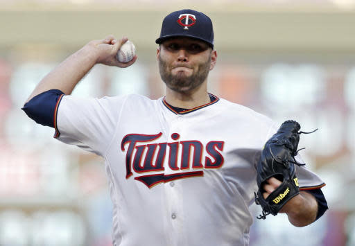 Minnesota Twins pitcher Lance Lynn throws against the Detroit Tigers in the first inning of a baseball game Tuesday, May 22, 2018, in Minneapolis. (AP Photo/Jim Mone)