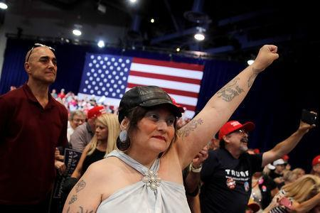 Supporters of U.S. President Donald Trump cheer at a rally in Las Vegas, Nevada, September 20, 2018. Picture taken September 20, 2018. REUTERS/Mike Segar
