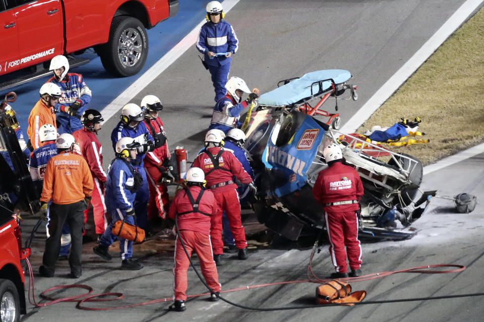 Rescue workers arrive to check on Ryan Newman after he was involved in a wreck on the last lap of the NASCAR Daytona 500 auto race at Daytona International Speedway, Monday, Feb. 17, 2020, in Daytona Beach, Fla. (AP Photo/David Graham)