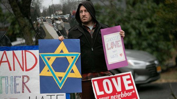 PHOTO: A man holds a sign outside the home of rabbi Chaim Rottenberg in Monsey, New York, Dec. 29, 2019. (Jeenah Moon/Reuters)