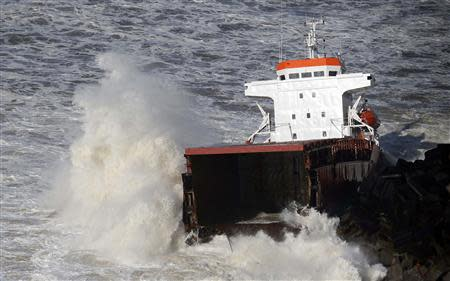 An aerial view show waves which break against a Spanish cargo ship carrying fertiliser, broken in two, off the beach in Anglet on the Atlantic Coast of France, February 5, 2014. REUTERS/Regis Duvignau