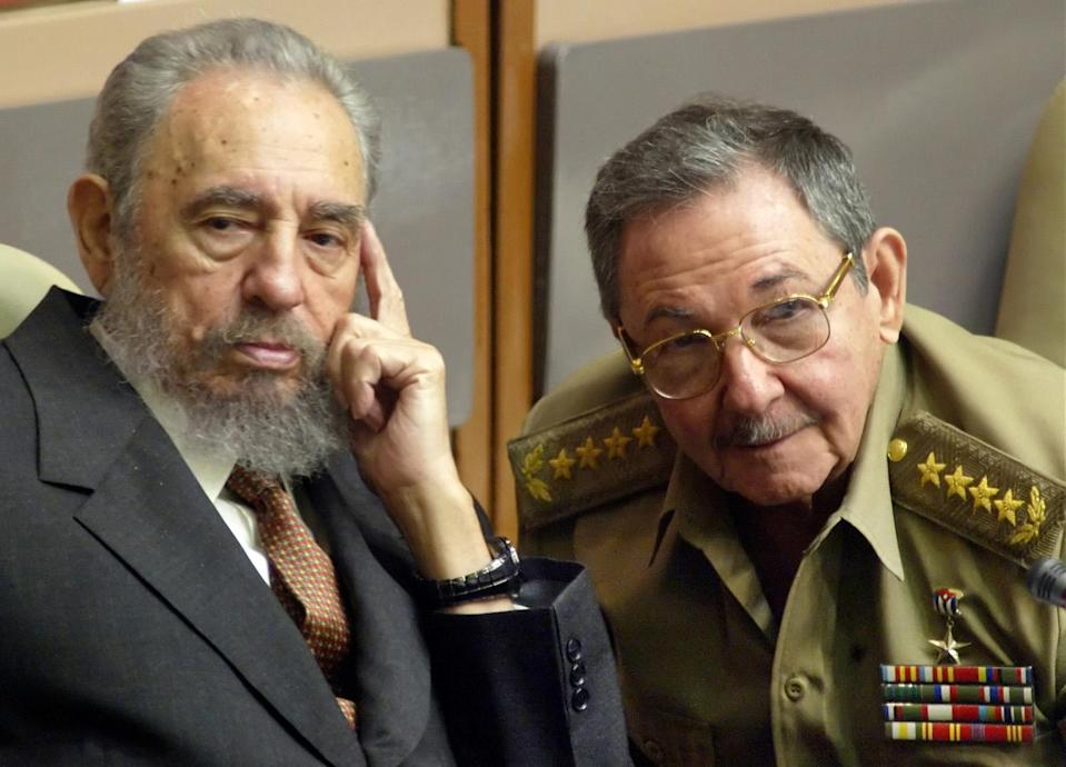 <p>Cuban President, Fidel Castro, left and his brother, the Minister of Defense Raul Castro, attend to a Cuban Parliament session, celebrated in the Convention Palace on Thursday July 1, 2004 in Havana, Cuba. (AP Photo/Cristobal Herrera) </p>