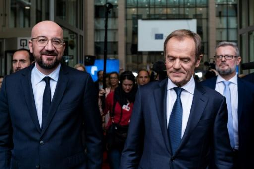 Newly appointed European Council President Charles Michel (L) is aiming for a more 'assertive' EU after taking over from Donald Tusk (R)