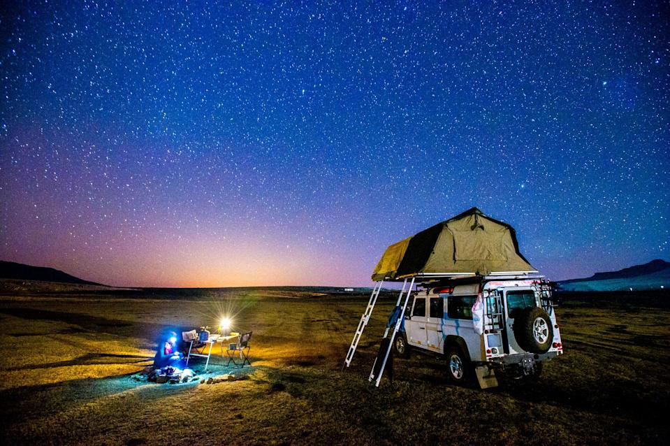 """<p>Hopefully, you'll be hitting the road this summer to visit <a href=""""https://www.countryliving.com/life/travel/g3468/most-beautiful-places-in-america/"""" rel=""""nofollow noopener"""" target=""""_blank"""" data-ylk=""""slk:the most beautiful places in American"""" class=""""link rapid-noclick-resp"""">the most beautiful places in American</a> for an extended summer vacation or at the very least, a weekend getaway. Whether you choose to travel by yourself, with family, or with friends, you can save a little money by skipping the expensive hotel room and sleeping over at a <a href=""""https://www.countryliving.com/life/travel/g4452/best-places-to-camp-national-parks/"""" rel=""""nofollow noopener"""" target=""""_blank"""" data-ylk=""""slk:National Park campsite"""" class=""""link rapid-noclick-resp"""">National Park campsite</a>. No camper? No problem. You can <a href=""""https://www.countryliving.com/life/travel/g33329960/car-camping-adventure-tips/"""" rel=""""nofollow noopener"""" target=""""_blank"""" data-ylk=""""slk:camp in your car"""" class=""""link rapid-noclick-resp"""">camp in your car</a>! You heard us: All you need is your everyday vehicle and these genius ideas, and you're good to go. </p><p>Sure, it may sound daunting to first-timers, but trust us, car camping is completely doable. Turn your car into a cozy, convenient, and budget-friendly accommodation and surround it with all the comforts of outdoor living—<a href=""""https://www.countryliving.com/shopping/g20915842/best-camping-chairs/"""" rel=""""nofollow noopener"""" target=""""_blank"""" data-ylk=""""slk:the best camping chairs"""" class=""""link rapid-noclick-resp"""">the best camping chairs</a>, <a href=""""https://www.countryliving.com/shopping/g30983323/best-hammocks/"""" rel=""""nofollow noopener"""" target=""""_blank"""" data-ylk=""""slk:best hammocks"""" class=""""link rapid-noclick-resp"""">best hammocks</a>, <a href=""""https://www.countryliving.com/shopping/g20978079/best-camping-stove/"""" rel=""""nofollow noopener"""" target=""""_blank"""" data-ylk=""""slk:the best camping stoves"""" class=""""link rapid-noclick-resp"""">the best camping stoves</a>—and you"""
