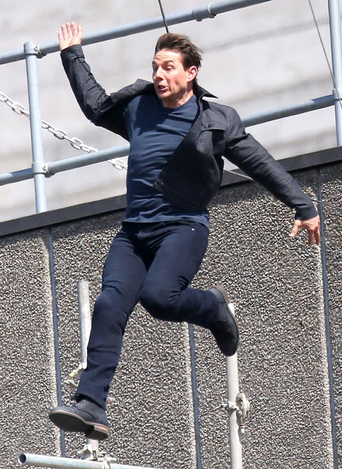"""<p>The actor has been doing his own stunts for years, but a mishap on the set of <em>M:I 6 — Mission Impossible</em> in August shut him — and the production — down. While jumping from a rigging onto a building, he came in at a bad angle and broke his ankle. """"Production will go on hiatus while Tom makes a full recovery,"""" the studio said in a statement, adding that the film is still scheduled to open on time next year. In case you were wondering, this isn't the end of the superstar doing his own stunts. Director Christopher McQuarrie insists he'll continue, saying that Cruise """"is in better shape … than I have seen him"""" on any of their many collaborations in the last 10 years. (Photo: Splash News) </p>"""