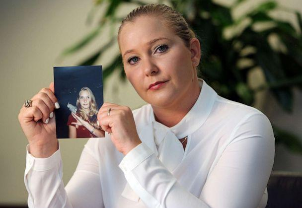 PHOTO: Virginia Roberts Giuffre holds a photo of herself at age 16, when she says Palm Beach multimillionaire Jeffrey Epstein began abusing her sexually, March 22, 2018. (Miami Herald/TNS via Getty Images, FILE)