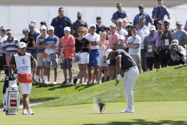 Brooks Koepka hits from the first fairway of the final round in the Northern Trust golf tournament at Liberty National Golf Course, Sunday, Aug. 11, 2019 in Jersey City, N.J. (AP Photo/Mark Lennihan)