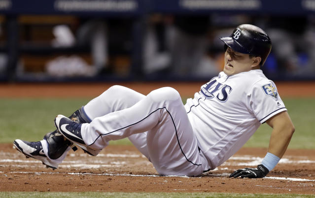 Tampa Bay Rays' Ji-Man Choi, of South Korea, goes down after being hit by a pitch from Cleveland Indians pitcher Corey Kluber with the bases loaded during the second inning of a baseball game Monday, Sept. 10, 2018, in St. Petersburg, Fla. Rays' Nicholas Ciuffo scored. (AP Photo/Chris O'Meara)