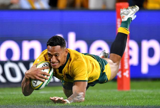 Rugby Union - June Internationals - Australia vs Ireland - Lang Park, Brisbane, Australia - June 9, 2018 - Israel Folau of Australia dives to score a try. AAP/Darren England/via REUTERS ATTENTION EDITORS - THIS IMAGE WAS PROVIDED BY A THIRD PARTY. NO RESALES. NO ARCHIVE. AUSTRALIA OUT. NEW ZEALAND OUT.