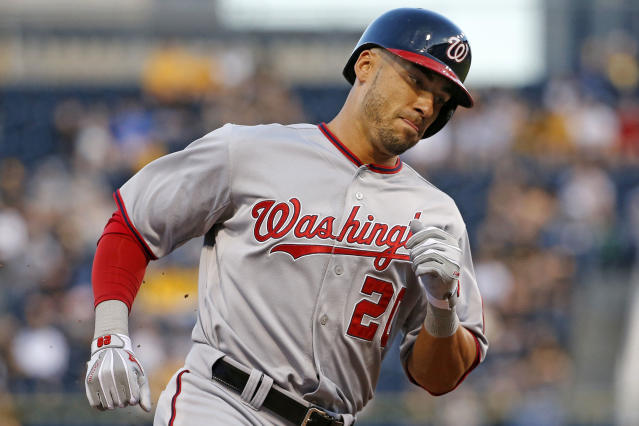 Washington Nationals' Ian Desmond rounds third after hitting a solo-home run off Pittsburgh Pirates starting pitcher Edinson Volquez during the fourth inning of a baseball game in Pittsburgh Thursday, May 22, 2014. (AP Photo/Gene J. Puskar)