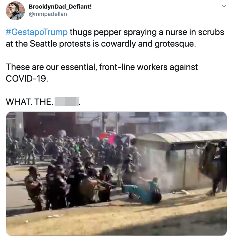 The video showed a woman in scrubs being pepper sprayed at close range. Source: Twitter