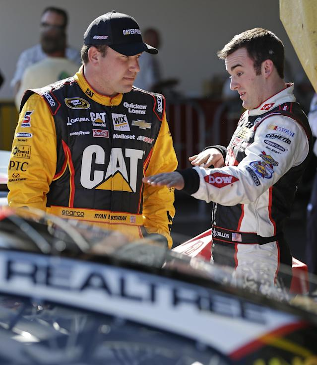 Drivers Ryan Newman, left, and Austin Dillon talk after their qualifying runs for the Daytona 500 NASCAR Sprint Cup Series auto race at Daytona International Speedway in Daytona Beach, Fla., Sunday, Feb. 16, 2014. Dillon won the pole position for the race. (AP Photo/John Raoux)