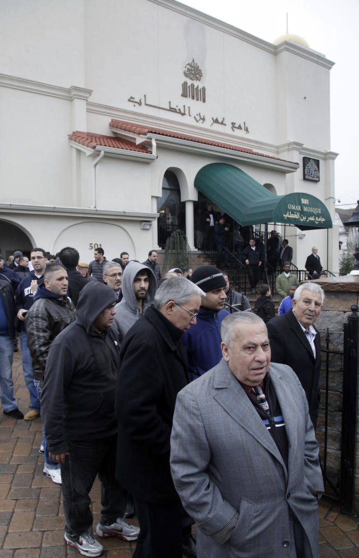 FILE - In this Feb. 24, 2012, file photo, a large crowd leaves the Masjid Omar mosque following afternoon prayers in Paterson, N.J. The Masjid Omar mosque was identified as a target for surveillance in a 2006 New York Police Department report uncovered by The Associated Press. The NYPD announced on Tuesday, April 15, 2014, that it has disbanded the special unit responsible for the surveillance program. (AP Photo/Mel Evans, File)