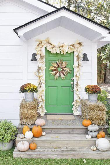 <p>Adorn the door with all things corn husk. Start with a flint corn and corn husk wreath and move onto a corn husk garland. Pumpkins and colorful mums round out the scene.<br><strong><br>Make the wreath</strong>: Start with a flat-wire 18-inch frame, then hot-glue corn husks (roughly 18) and corncobs (roughly 9) in an alternating pattern. Fray the ends of the corn husks to add more dimension.<br></p>