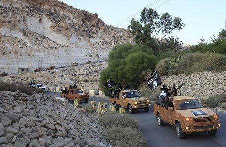 An armed motorcade belonging to members of Derna's Islamic Youth Council, consisting of former members of militias from the town of Derna, drive along a road in Derna, eastern Libya