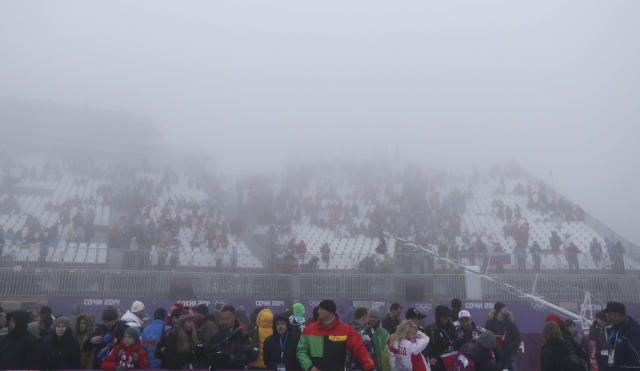 Fog sits over the stands prior to a men's snowboard cross competition at the Rosa Khutor Extreme Park, at the 2014 Winter Olympics, Monday, Feb. 17, 2014, in Krasnaya Polyana, Russia. (AP Photo/Sergei Grits)