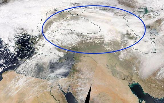 Dust plume seen within storm systems in far eastern Europe and western Eurasia.