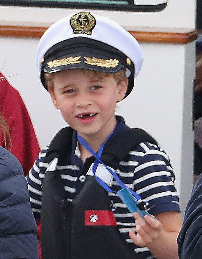 <p>Prince George dons a captain's hat and shows off his missing front teeth at the King's Cup.</p>